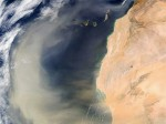 Satellite image showing a cloud of Saharan sand blown off the west coast of Africa. Credit: NASA.
