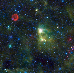 Composite wide-field infrared image, with SN1572 (Tycho Supernova Remnant) upper left. Blue and cyan indicate infrared wavelengths of 3.4 and 4.6 microns, while green and red show objects radiating at 12 and 22 microns. Credit: NASA/JPL-Caltech/WISE Team.