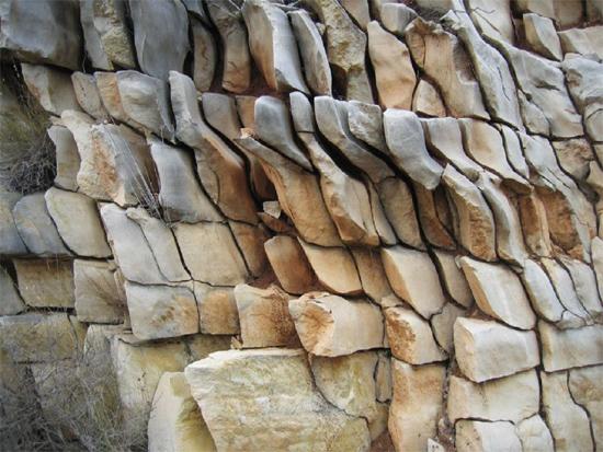 Strangely fractured rock strata near Guadalest, Spain