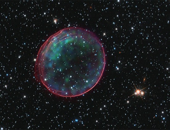 Supernova Remnant 0509: X-ray in blue and green, optical in red.