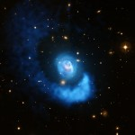 What looks like blue light and hot gas but isn't? Credit: X-ray: NASA/CXC/BU/E.Blanton; Optical: ESO/VLT