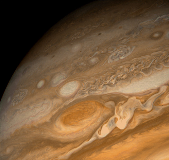 The Great Red Spot on Jupiter surrounded by smaller rotating cells. Credit: Voyager 2/NASA-JPL.