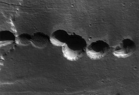 A chain of electrically etched craters in the Alba Terra region of Mars. Credit: NASA/JPL/University of Arizona