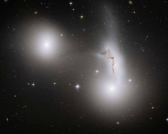 Three interacting galaxies: NGC 7173 (middle left), NGC 7174 (middle right), and NGC 7176 (lower right). Credit: NASA, ESA, and R. Sharples (University of Durham)
