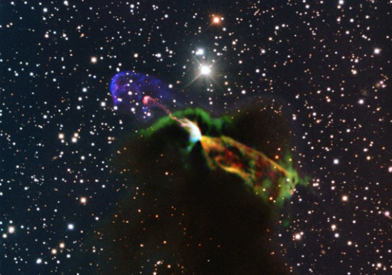 Radio signals (orange and green) reveal the counterpart, hidden in dusty plasma, to the visible jet (pink and purple) of a Herbig-Haro star. Credit: ESO/ALMA (ESO/NAOJ/NRAO)/H. Arce. Acknowledgements: Bo Reipurth