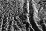 """Tiger stripes"" in Damascus Sulcus, Enceladus. Credit: NASA/JPL/Space Science Institute Universities Space Research Association/Lunar & Planetary Institute."